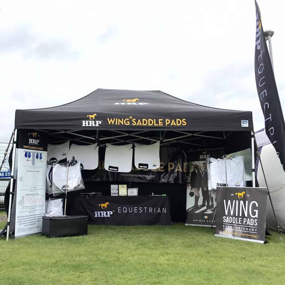 Event branding including printed pop up gazebo, flags, tablecloth & roller banners | XG Group