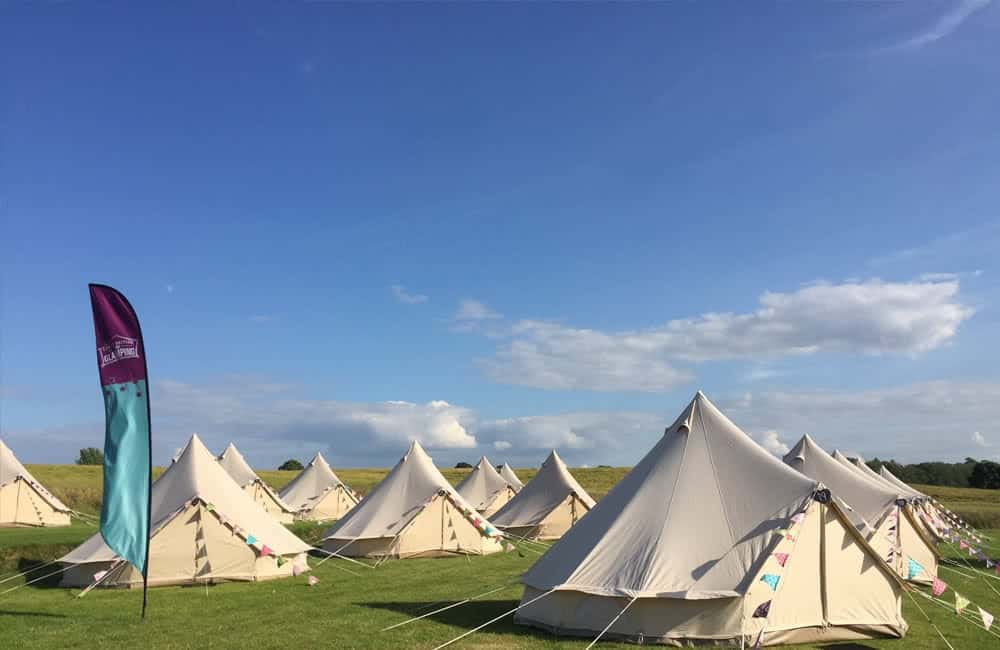 Large branded feather flags - Great British Glamping | XG Group