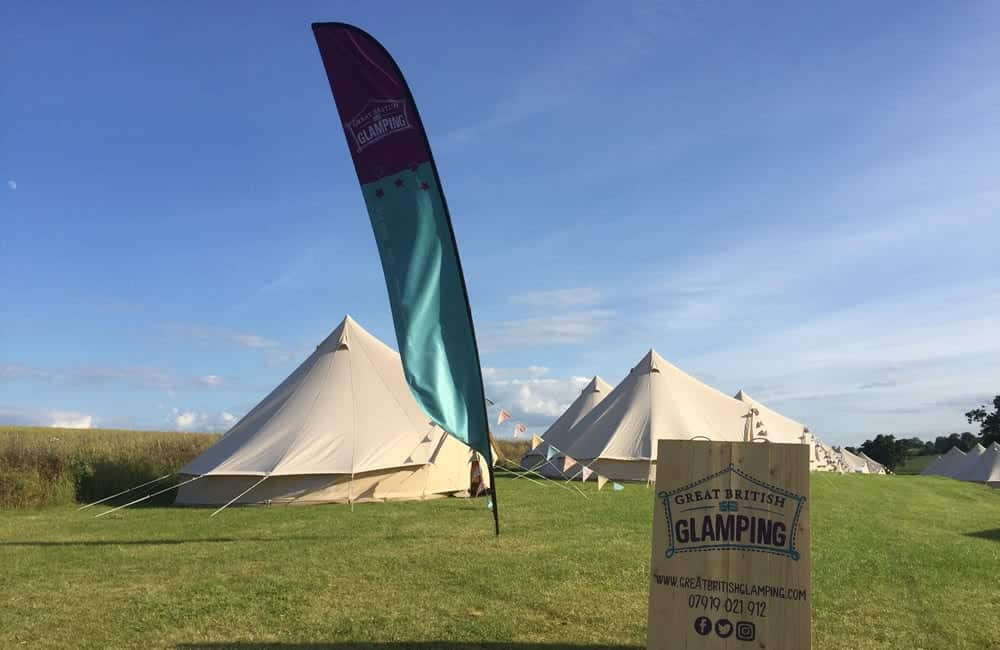 Large branded feather flags custom printed for Great British Glamping