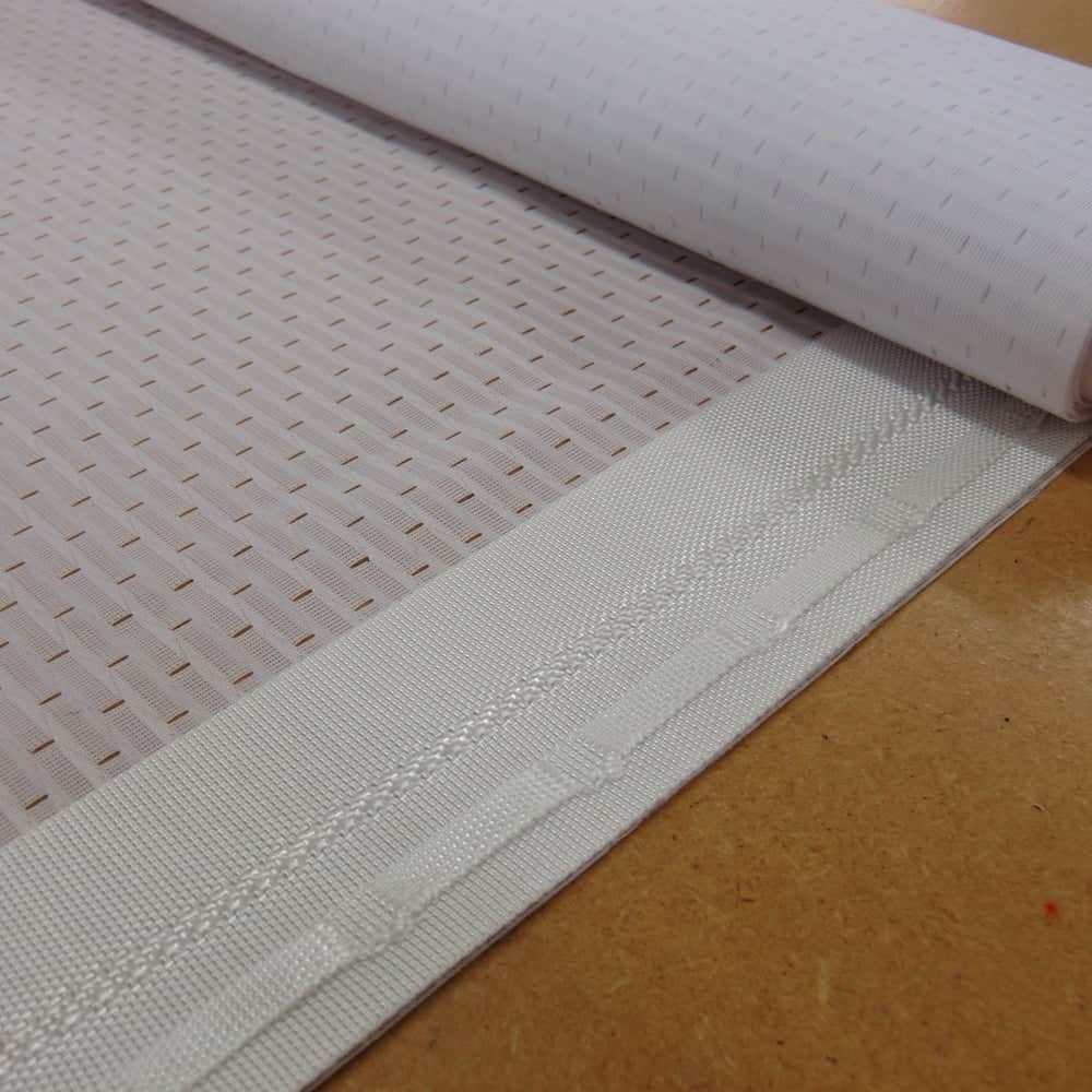 Heras fencing finishing continuous eyelet webbing close up | XG Group