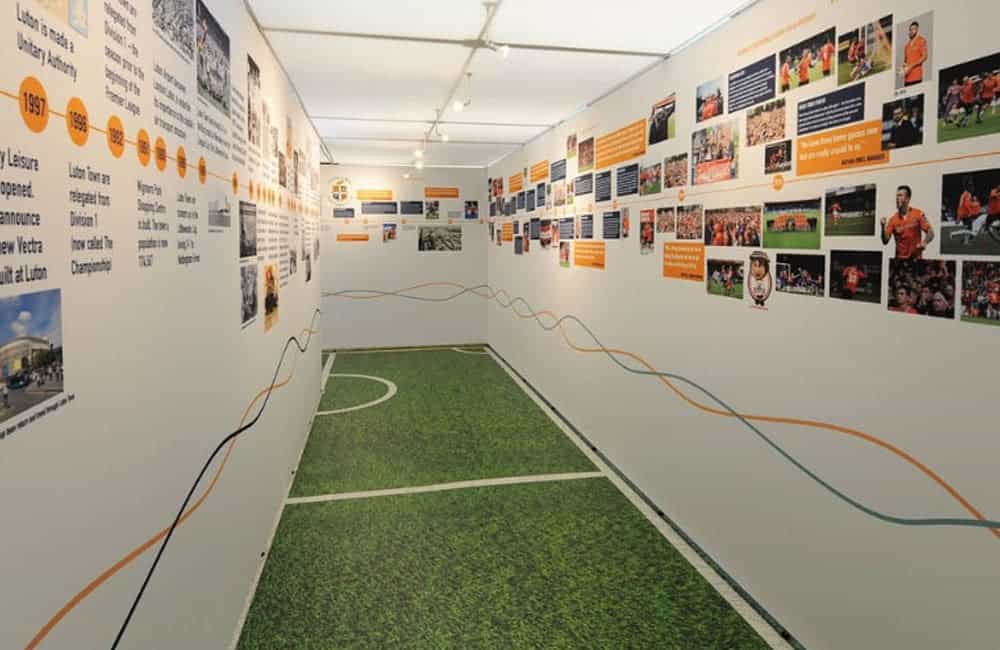 Branded experience corridor for Luton FC Public Consultation roadshow graphics | XG Group