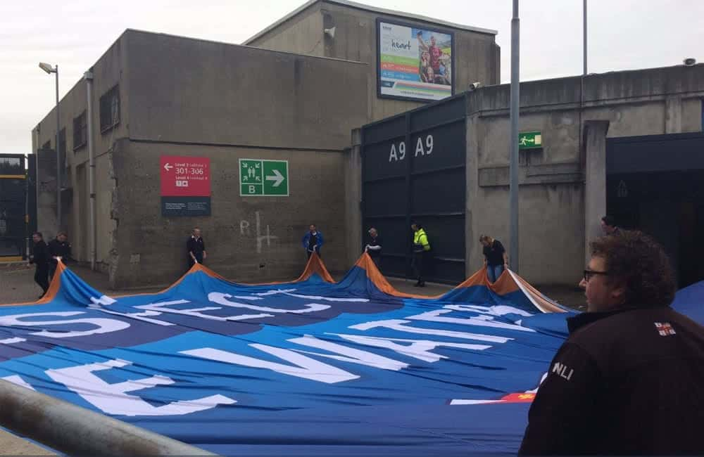 RNLI giant pitch banner being carried into Croke Park Stadium | XG Group