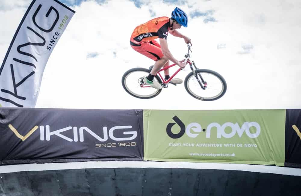 Branded crowd barrier covers for StreetVelodrome events | XG Group