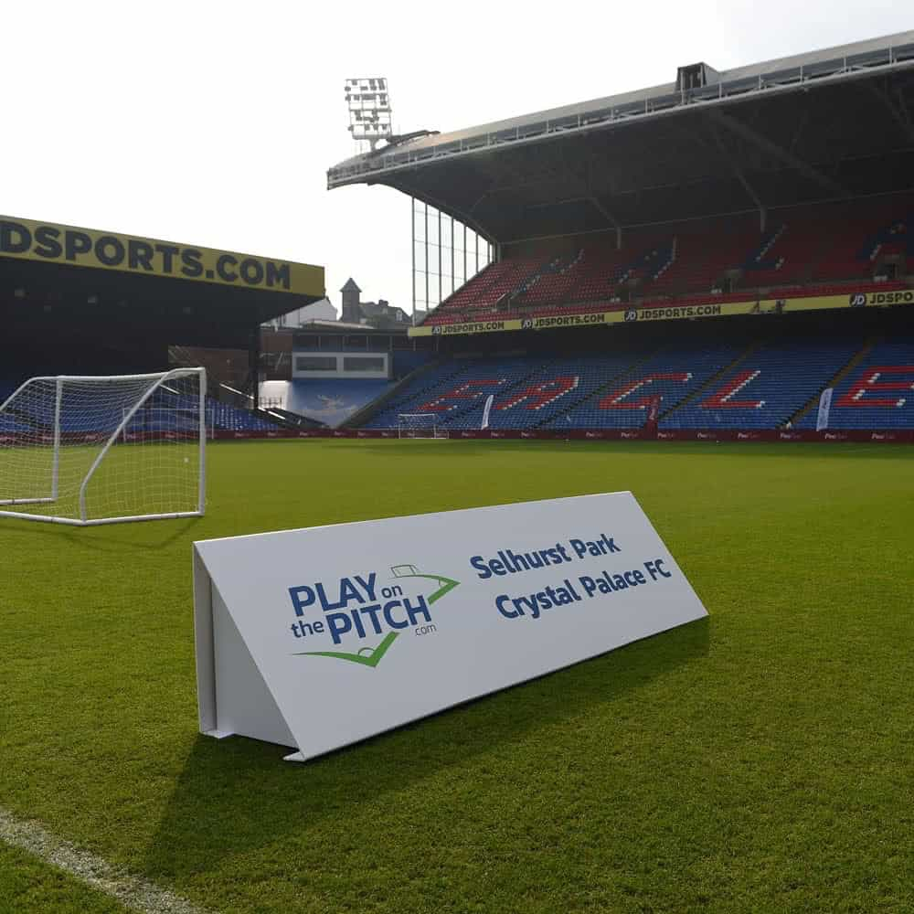 Printed toblerone event signage banner on pitch | XG Group